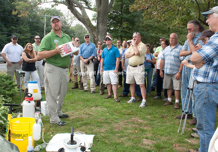 NAUGATUCK CT.-12 SEPTEMBER 2013 091213DA04- Aaron Dickinson of Rainbow Tree Care educates the area professionals and residents how to treat and prevent the Emerald Ash Boarer Beetle found in area trees on Prospect St. in Naugatuck on Thursday.<br /> Darlene Douty Republican American