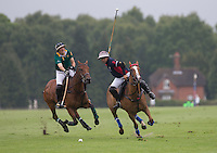 Alejandro Muzzio (King Power) hits a shot during the Cartier Queens Cup Final match between King Power Foxes and Dubai Polo Team at the Guards Polo Club, Smith's Lawn, Windsor, England on 14 June 2015. Photo by Andy Rowland.