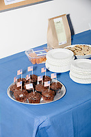 Chocolate cupcakes decorated with American flags are seen on a table at the Milford Democrats' Potluck Supper at the Unitarian Universalist Congregation Church in Milford, New Hampshire, USA, on Sat., Apr. 6, 2019. Democratic presidential candidate and Congressional Representative Eric Swalwell (D-CA 15th) spoke at the event. Swalwell is running primarily on gun control issues.