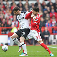 Nottingham Forest's Tobias Figueiredo in action with Derby County's David Nugent<br /> <br /> Photographer Mick Walker/CameraSport<br /> <br /> The EFL Sky Bet Championship - Nottingham Forest v Derby County - Sunday 11th March 2018 - The City Ground - Nottingham<br /> <br /> World Copyright &copy; 2018 CameraSport. All rights reserved. 43 Linden Ave. Countesthorpe. Leicester. England. LE8 5PG - Tel: +44 (0) 116 277 4147 - admin@camerasport.com - www.camerasport.com