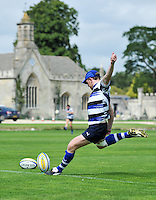 Sam Vesty kicks for the posts. Bath Rugby training session on August 2, 2011 at Farleigh House in Bath, England. Photo by: Patrick Khachfe/Onside Images