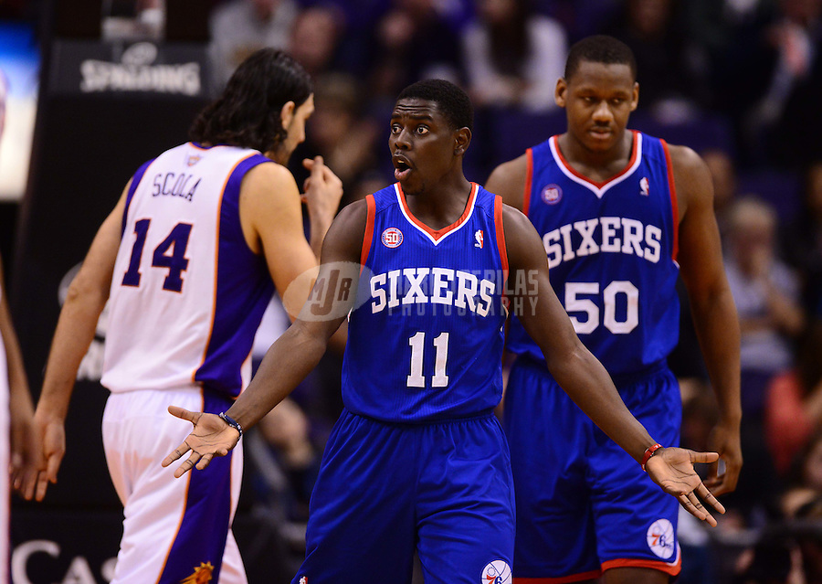 Jan. 2, 2013; Phoenix, AZ, USA: Philadelphia 76ers guard Jrue Holiday (11) reacts to a foul call against the Phoenix Suns at the US Airways Center. The Suns defeated the 76ers 95-89. Mandatory Credit: Mark J. Rebilas-USA TODAY Sports