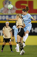 Heather O'Reilly (9) of Sky Blue FC and Leslie Osborne (10) of FC Gold Pride go up for a header. Sky Blue FC and FC Gold Pride played to a 1-1 tie during a Women's Professional Soccer match at TD Bank Ballpark in Bridgewater, NJ, on April 11, 2009. Photo by Howard C. Smith/isiphotos.com