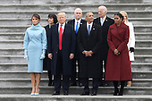 From left, first lady Melania Trump, Karen Pence, United States President Donald Trump, Vice President Mike Pence, former US President Barack Obama, former vice president Joe Biden, Michelle Obama and Jill Biden stand on the steps of the U.S. Capitol on Friday, Jan. 20, 2017, in Washington, after Trump's inauguration ceremony. <br /> Credit: Rob Carr / Pool via CNP