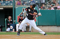 Eddie Rosario (13) of the New Britain Rock Cats bats during a game against the Reading Fightin Phils at New Britain Stadium on July 13, 2014 in New Britain, Connecticut. Reading defeated New Britain 6-4.  (Gregory Vasil/Four Seam Images)