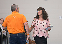 NWA Democrat-Gazette/BEN GOFF @NWABENGOFF<br /> Lisa St. John, principal of Osage Creek Elementary School, steps up to make remarks after an introduction by Bentonville School Board president Travis Riggs Friday, Aug. 11, 2017, during a grand opening for Osage Creek Elementary School and Creekside Middle School in Bentonville. The new schools will welcome their first students Monday.