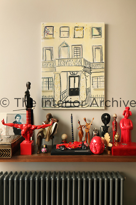A model racing car set amongst a collection of kitsch red and black ornaments reveals Tarja's passion for sport