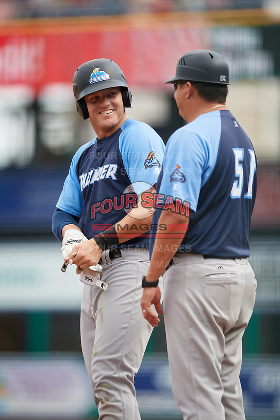 Trenton Thunder left fielder Trey Amburgey (14) talks with defensive coach Raul Dominguez (51) on first base during a game against the Hartford Yard Goats on August 26, 2018 at Dunkin' Donuts Park in Hartford, Connecticut.  Trenton defeated Hartford 8-3.  (Mike Janes/Four Seam Images)