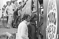 Professional surfer Bruce Raymond (AUS) with surfboard shaper Kym Thompson (AUS)  standing at the judging sheds during the  running of the 1976 Rip Curl Pro, Bells Beach, Torquay, Victoria, Australia. Easter 1976.Photo:  joiliphotos.com