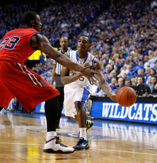 Freshman guard Marquis Teague passes the ball during the first half of the game against the University of Mississippi in Lexington, Ky., on Saturday, Feb. 18, 2012. Photo by Tessa Lighty | Staff