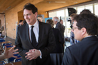 PQ MNAs Bernard Drainville and Pierre-Karl Peladeau chat with a young supporter during the presentation of parti Quebecois candidates for the upcoming byelection Tuesday May 5, 2015.