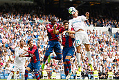 9th September 2017, Santiago Bernabeu, Madrid, Spain; La Liga football, Real Madrid versus Levante; Gareth Bale (11) of Real Madrid goes up for the header with Erick Cabaco (18) of Levante