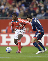 Jay Heaps (Revolution, blue) grabs some shirt to control Edson Buddle (Toronto, red). New England Revolution defeated Toronto FC, 4-0, at Gillette Stadium in Foxborough MA on April 14, 2007. The 4th goal was the Revolution team's 500th goal.