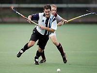 Hampstead / Loughborough Students<br /> Mens Premier Division<br /> Paddington Rec, Maida Vale, Nov 28, 2004<br /> Pic : Max Flego (Tel : 07870-553631)<br /> Tim Thompson battles a Loughborough player for possession