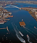 Aerial photographs of the Tugboat, Ranger (Crowley Maritime) pulling 17 barges through the New York Harbor<br /> <br /> 3/25/2009.