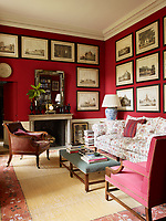 In the den, the walls and 18th century Chippendale armchair at right are covered in a Pierre Frey red fabric, the sofa by Howard and Sons is upholstered in a Charles Burger cotton and the leather armchair is Regency; the custom made tatami mat was inspired by an 18th century design.