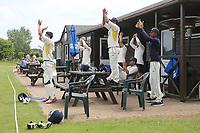 Rainham players applaud the half century of Jon Oneil Bentley CC (Bowling) vs Rainham CC, T Rippon Mid Essex Cricket League Cricket at Coxtie Green Road on 9th June 2018