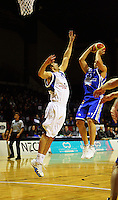 Brendon Polybank shoots under pressure from Adrian Majstrovich during the NBL Round 14 basketball match between the Wellington Saints and Auckland Stars at TSB Bank Arena, Wellington, New Zealand on Thursday 29 May 2008. Photo: Dave Lintott / lintottphoto.co.nz