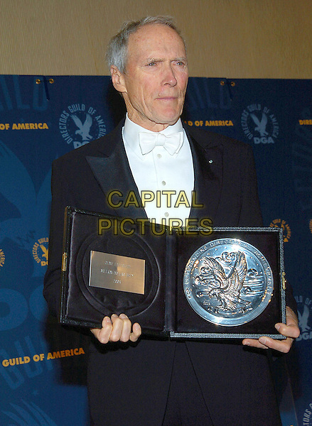 CLINT EASTWOOD.57th Annual DGA Awards held at the Beverly Hilton Hotel, Beverly Hills, California, USA, 29 January 2005..half length award trophy plate.Ref: ADM.www.capitalpictures.com.sales@capitalpictures.com.©Jacqui Wong/AdMedia/Capital Pictures .