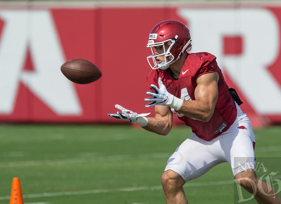 NWA Democrat-Gazette/BEN GOFF @NWABENGOFF<br /> Chase Harrell, Arkansas tight end, catches a pass Wednesday, Aug. 7, 2019, at the Arkansas practice fields in Fayetteville.