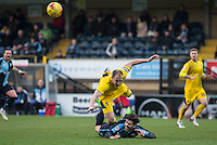 Mark McChrystal of Bristol Rovers gives Max Kretzschmar of Wycombe Wanderers a shove during the Sky Bet League 2 match between Wycombe Wanderers and Bristol Rovers at Adams Park, High Wycombe, England on 27 February 2016. Photo by Andy Rowland.