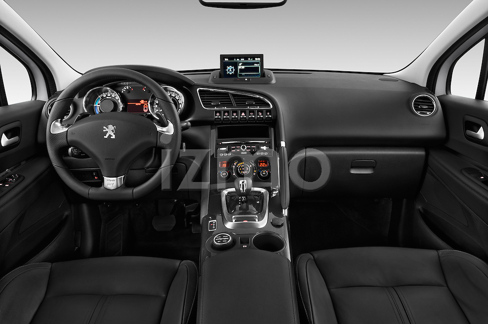 Straight dashboard view of a 2012 - 2014 Peugeot 3008 Hybrid4 SUV.