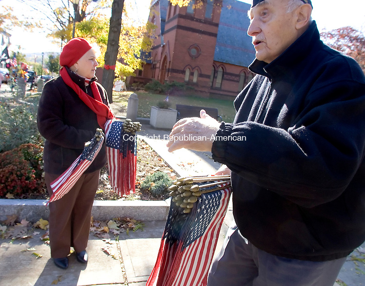 NAUGATUCK, CT- 11 NOV 2007- 111107JT05- <br /> Geri Stotz and Army veteran Fran Keith brought 400 flags to give away to children at the Naugatuck Green for Sunday's Veterans Day parade and ceremony <br /> Josalee Thrift / Republican-American