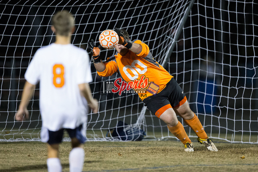 Grayson Owens (00) of the Carson Cougars defends his goal during first half action against the Asheville Cougars at Jesse C. Carson High School on November 12, 2015 in China Grove, North Carolina.  The Asheville Cougars defeated the Carson Cougars 3-2 in the third round of the 2015 NCSHAA 3A playoffs.  (Brian Westerholt/Sports On Film)