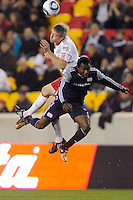John Wolyniec (15) of the New York Red Bulls battles Kenny Mansally (7) of the New England Revolution for a header during a U. S. Open Cup qualifier round match at Red Bull Arena in Harrison, NJ, on May 12, 2010.