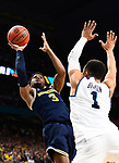 SAN ANTONIO, TX - APRIL 02:  Zavier Simpson #3 of the Michigan Wolverines shoots the ball Jalen Brunson #1 of the Villanova Wildcats during the second half in the 2018 NCAA Men's Final Four National Championship game at the Alamodome on April 2, 2018 in San Antonio, Texas.  (Photo by Brett Wilhelm/NCAA Photos via Getty Images)