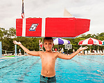 Indianola Park and Recreations hosted cardboard boat races at the Veteran's Memorial Aquatic Center July 22. Tucker Nelson celebrates winning the races in his boat the USS America.