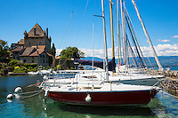 Yachts by the 12th Century medieval castle in the old port of Yvoire on Lac Leman, Lake Geneva,  France