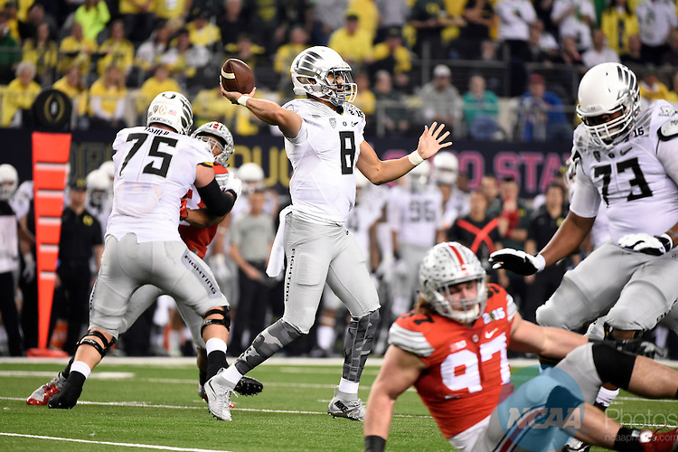 12 JAN 2015:  Marcus Mariota (8) of the University of Oregon passes against the Ohio State University during the College Football Playoff National Championship held at AT&T Stadium in Arlington, TX.  Ohio State defeated Oregon 42-20 for the national title.  Jamie Schwaberow/NCAA Photos