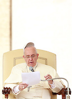 Papa Francesco tiene l'udienza generale del mercoledi' in Piazza San Pietro, Citta' del Vaticano, 15 ottobre 2014.<br /> Pope Francis has his skull cap blown by the wind during his weekly general audience in St. Peter's Square at the Vatican, 15 October 2014.<br /> UPDATE IMAGES PRESS/Isabella Bonotto<br /> <br /> STRICTLY ONLY FOR EDITORIAL USE