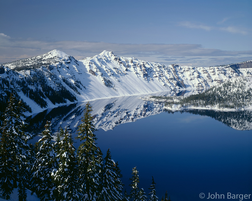 ORCL_011 - USA, Oregon, Crater Lake National Park, Winter snow on west rim of Crater Lake with The Watchman (left) and Hillman Peak (center).