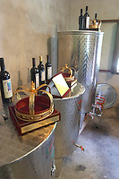 The winery, small scale production, with stainless steel fermentation and storage tanks. A crown displayed on a tank, signifying that the winemaker is considered the king of wine in Montenegro. Durovic Jovo Winery, Dupilo village, wine region south of Podgorica. Vukovici Durovic Jovo Winery near Dupilo. Montenegro, Balkan, Europe.