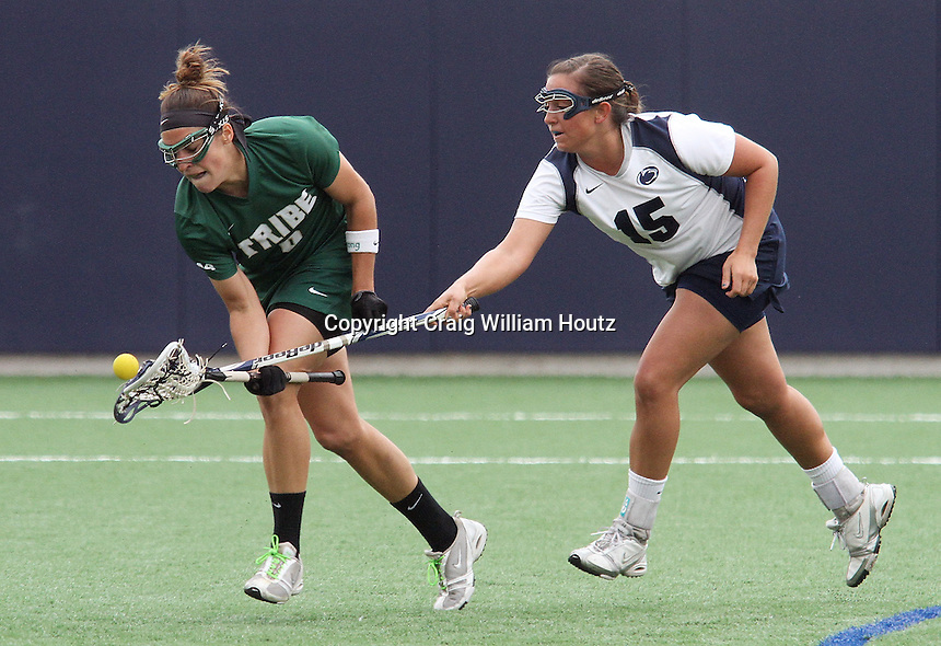 Penn State's Mackenzie Cyr (15) and William & Mary's Denise Lenihan battle for control of a ground ball on Sunday, March 25, 2012.  Cyr had two goals in #9 Penn State's 9-7 win.   Photo/©2012 Craig Houtz