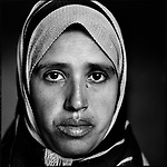 She was a shadow in a doorway looking at me as I walked away from the devastation of the Samoni family compound where 27 members of the clan had been killed by Israeli forces. A few minutes later a man cautiously walked up to me and asked if I would like to speak to Ranya Samoni, the wife of Eyad Samoni, one of the Samoni clan who had died? I hesitated long enough for him to say She wants to speak to you.<br /> <br /> The massacre of the Samoni clan at the hands of Israeli soldiers has be reported by every major print, TV and internet news organization covering the aftermath of Israeli's Operation Cast Lead. But that afternoon I and writer Elliott Woods were the audience to one woman talking about her one husband and explaining to us the meaning and consequences of her one, personal loss. <br /> <br /> Behind the story about the clan there were still the individuals left to carry individual pain and loss.