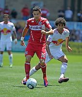 Chicago midfielder Marco Pappa (16) dribbles away from New York midfielder Mehdi Ballouchy (10).  The Chicago Fire tied the New York Red Bulls 1-1 at Toyota Park in Bridgeview, IL on June 26, 2011.