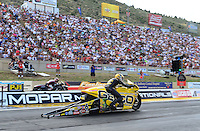 Jul, 22, 2012; Morrison, CO, USA: NHRA pro stock motorcycle rider Karen Stoffer (near lane) races alongside Andrew Hines during the Mile High Nationals at Bandimere Speedway. Mandatory Credit: Mark J. Rebilas-