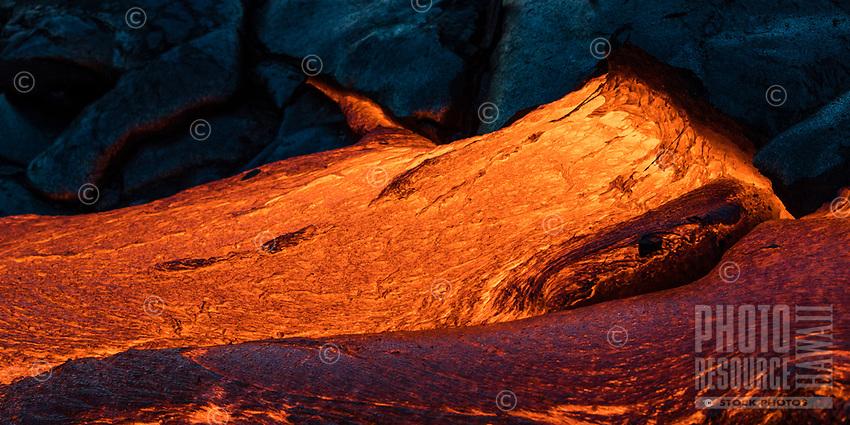 Glowing textured lava on the coastal plains of Pulama Pali (part of Holei Pali), Hawai'i Volcanoes National Park, Puna, Hawai'i Island, December 2017.