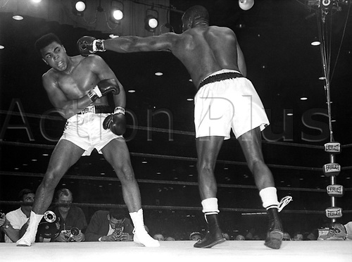 """25.05.1965. Lewiston, Maine, USA. Cassius Clay (r) skilfully avoids Charles """"Sonny"""" Liston's left. Challenger Cassius Clay won the title against defending champion Liston. Muhammad Ali died on June 3rd 2016 of a respiratory complication in a Phoenix hospital."""