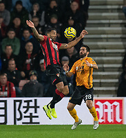 Bournemouth's Callum Wilson (left) battles for possession with Wolverhampton Wanderers' Joao Moutinho (right) <br /> <br /> Photographer David Horton/CameraSport<br /> <br /> The Premier League - Bournemouth v Wolverhampton Wanderers - Saturday 23rd November 2019 - Vitality Stadium - Bournemouth<br /> <br /> World Copyright © 2019 CameraSport. All rights reserved. 43 Linden Ave. Countesthorpe. Leicester. England. LE8 5PG - Tel: +44 (0) 116 277 4147 - admin@camerasport.com - www.camerasport.com