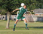 A member of the Slidell Soccer team heads the ball during play at Lafreniere.