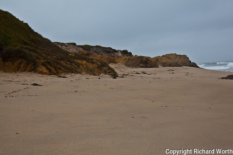 Like hungry animals, the craggy bluffs look as though they are gobbling the sand, when in fact it is they that are being eaten by wind and sea, becoming the sandy beach.