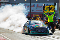 Oct 28, 2017; Las Vegas, NV, USA; NHRA pro stock driver Deric Kramer does a burnout in his Days of Thunder themed car driven by character Cole Trickle during qualifying for the Toyota National at The Strip at Las Vegas Motor Speedway. Mandatory Credit: Mark J. Rebilas-USA TODAY Sports