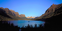 St. Mary Lake surrounded by the high peaks of Glacier National Park at sunrise.