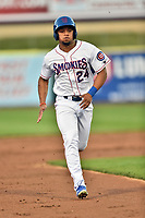 Tennessee Smokies left fielder Charcer Burks (24) runs to third base during a game against the Mississippi Braves at Smokies Stadium on April 12, 2017 in Kodak, Tennessee. The Braves defeated the Smokies 6-2. (Tony Farlow/Four Seam Images)