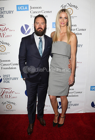 "BEVERLY HILLS, CA - April 28: Mark-Paul Gosselaar, Catriona McGinn, At UCLA Jonsson Cancer Center Foundation Hosts 22nd Annual ""Taste for a Cure"" At The Regent Beverly Wilshire Hotel In California on April 28, 2017. Credit: FS/MediaPunch"