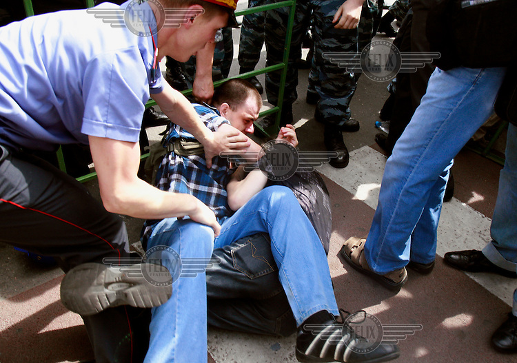 Police stop a gay activist (right) from being beaten up by a nationalist protestor (left) as Russian authorities, neo-Nazis and Orthodox Christians try to forcefully prevent gay and lesbian rights activists from rallying in Moscow. Although homosexuality was decriminalised in Russia in 1993, Moscow has repeatedly banned many gay pride parades, including this one.